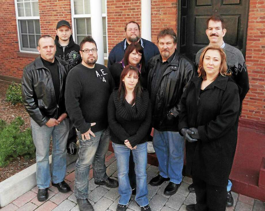 Members of the Ghosts of New England Research Society stand in front of the Armory in Middletown. Photo: Courtesy Ghosts Of New England Research Society