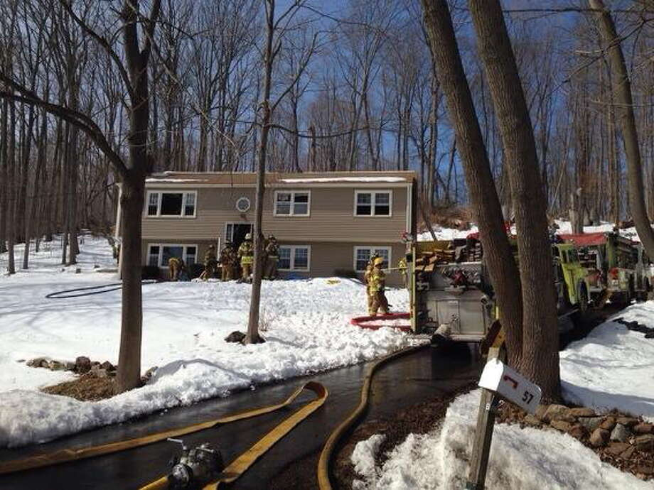 Firefighters at the scene of a house fire in Durham on David Road on Thursday, March 6, 2014. Photo: Kaitlyn Schroyer — Middletown Press