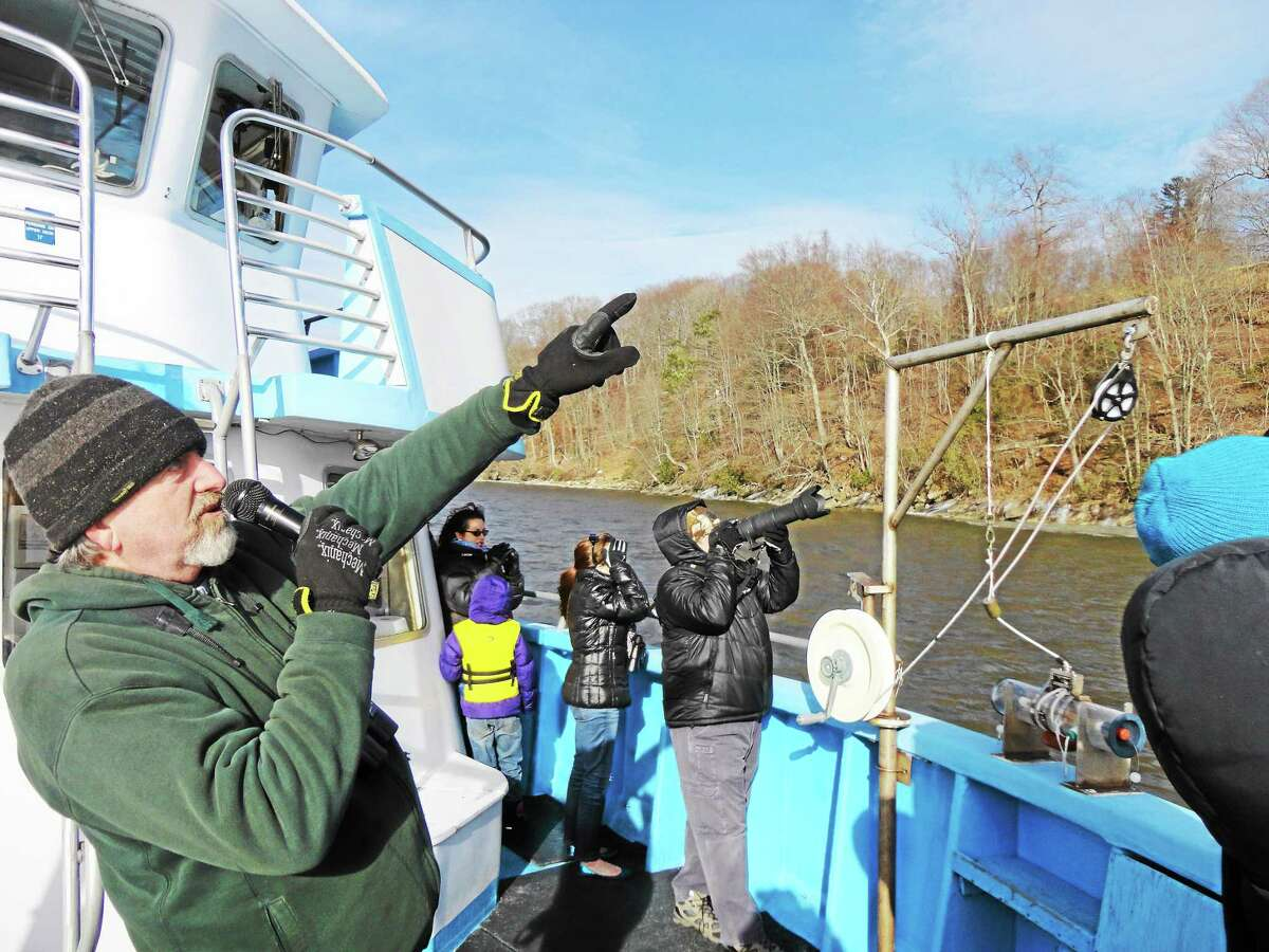 Environmental educator Bill Yule leads the boat tours and helps participants spot bald eagles, wintering hawks and water fowl and other wildlife from the deck of Enviro-Lab III in Essex.