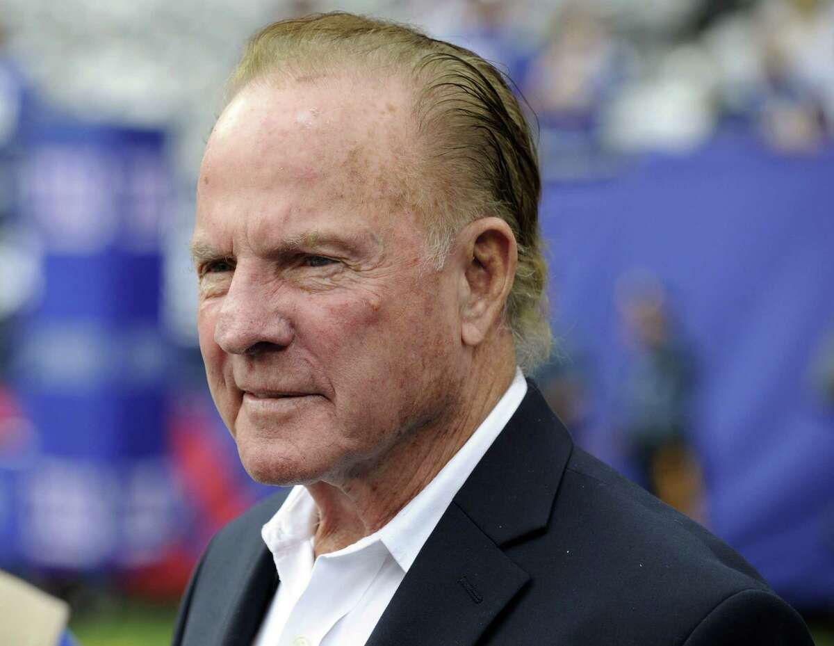 In this Sept. 15, 2013 file photo, former New York Giants halfback Frank Gifford looks on before a game between the Giants and the Denver Broncos in East Rutherford, N.J. Gifford's family on Sunday said he died suddenly of natural causes. He was 84.