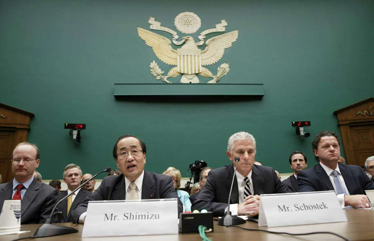 Hiroshi Shimizu, center left, senior vice president of global quality assurance at Takata, joined at right by Rick Schostek, executive vice president of Honda North America, and Craig Westbrook, far right, vice president for aftersales for BMW of North America, testifies on Capitol Hill in Washington, Wednesday, Dec. 3, 2014, before the House Commerce, Manufacturing, and Trade subcommittee heating to examine ruptures and recalls of defective air bags made by Takata. (AP Photo/J. Scott Applewhite)