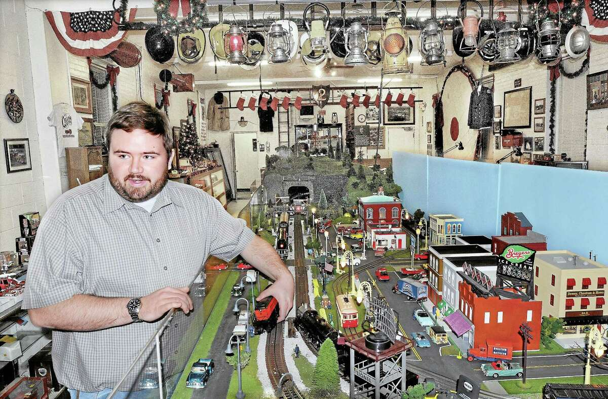 Michael Tierney of Portland talks about the O-gauge model train at the holiday toy train display at the Connecticut Cellar Savers Fire Museum, 634 Main St., in this file photo from December 2011.