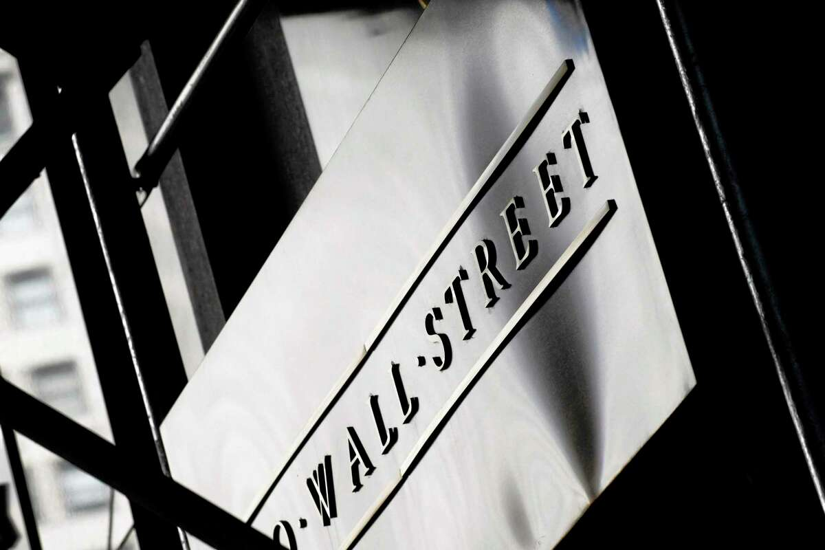 The Associated Press A sign for Wall Street outside the New York Stock Exchange, in New York.