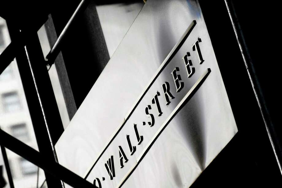 The Associated Press A sign for Wall Street outside the New York Stock Exchange, in New York. Photo: AP / AP