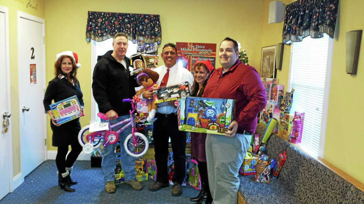 Last year, Dr. James Milone of the Milone Chiropractic Center in Clinton helped participated in the holiday toy drive, by collecting a large number of toys at his East Main Street office. From left are: Kristen Caron of Milone Chiropractic; Sgt. Jeremiah Dunn, toy drive coordinator; Dr. James Milone, Angela Milone and Craig Allen of Milone in this file photo.