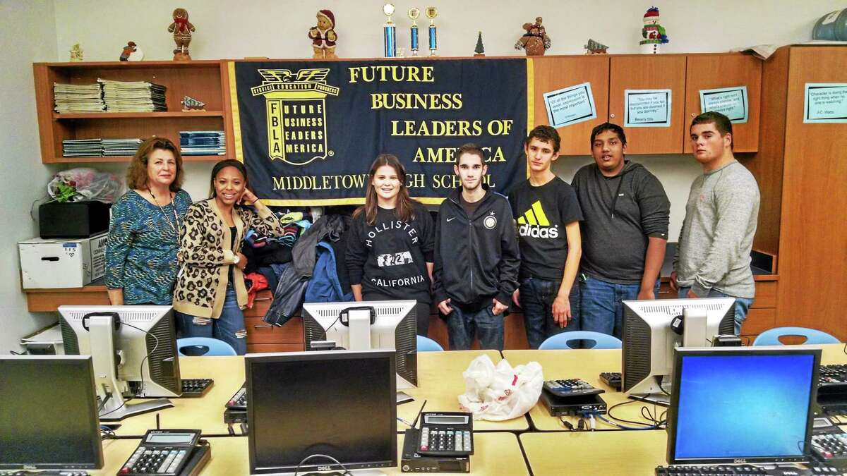 From left are: Middletown High School Future Business Leaders of America club advisor Joan Harvey, Aryan White, Alexis Volpe, Ben Salazar, Kyle Rand, Ryan Debedin and Jeff Daniels.