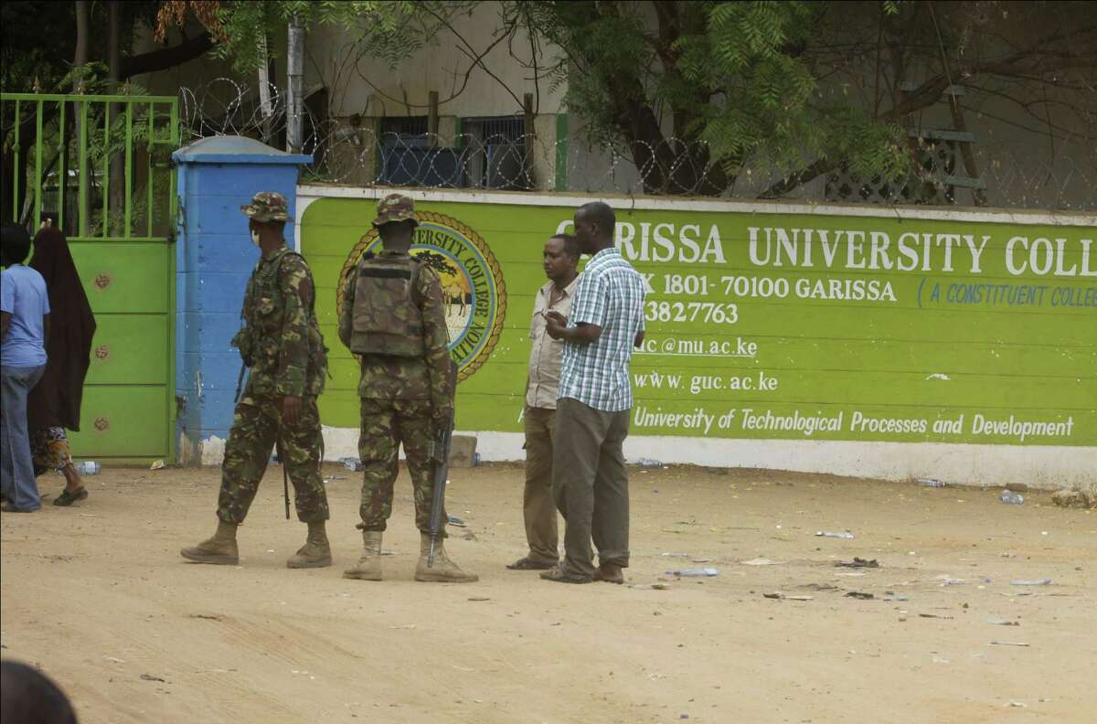 A member of Kenya Defense Forces secures the area of the Garissa University College in Garissa, northeastern Kenya, Friday. Al-Shabab gunmen rampaged through the university at dawn Thursday, killing 147 people in the group's deadliest attack in the east African country.