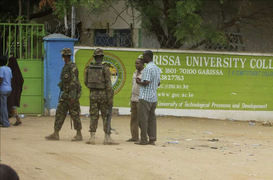 A member of Kenya Defense Forces secures the area of the Garissa University College in Garissa, northeastern Kenya, Friday. Al-Shabab gunmen rampaged through the university at dawn Thursday, killing 147 people in the group's deadliest attack in the east African country. Photo: Associated Press  / AP
