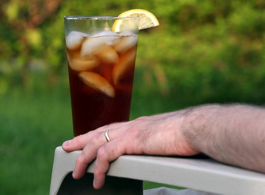 This May 21, 2007 file photo shows a glass of iced tea in Concord, N.H. Doctors have traced an Arkansas man's kidney failure to an unusual cause — his habit of drinking a gallon of iced tea each day. He said he drank about 16 8-ounce cups of iced tea every day. Black tea has the chemical oxalate which known to cause kidney stones or even kidney failure in excessive amounts. The man is on dialysis, perhaps for the rest of his life. The case report is in the Thursday, April 2, 2015 issue of the New England Journal of Medicine. Photo: Associated Press File Photo / AP