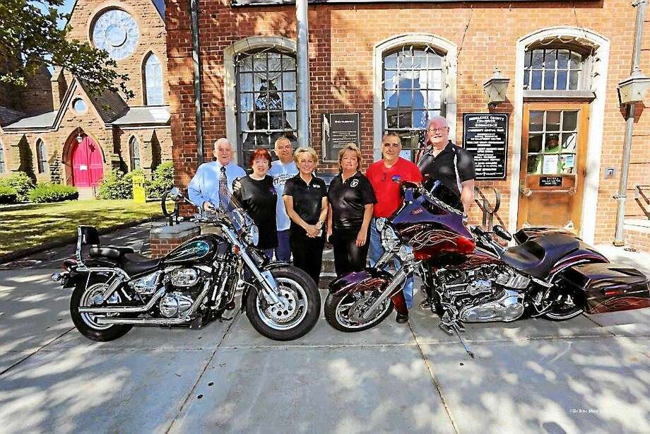 The long-awaited 2015 Motorcycle Mania will take over Main Street Wednesday from 5-9 p.m. with more than 6,000 bikes expected. A lot of hard work for this 10th annual event goes into the planning. Shown are Larry McHugh, president, Middlesex County Chamber of Commerce; Ellen & Chris Hinze, event planning committee; Donna Hunter & Dana Hunter-Moyer, sponsors Hunter's Ambulance; Hunter Limousines & the Hunter Family; Rich Greco, event chairman; Tom Byrne, Central Business Bureau chairman. Photo: Bill De Kine — De Kine Photo