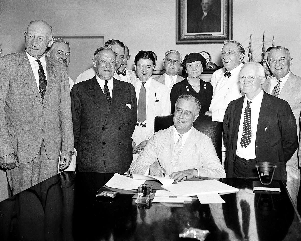 This Aug. 14, 1935 file photo shows President Franklin D. Roosevelt signing the Social Security Bill in Washington.