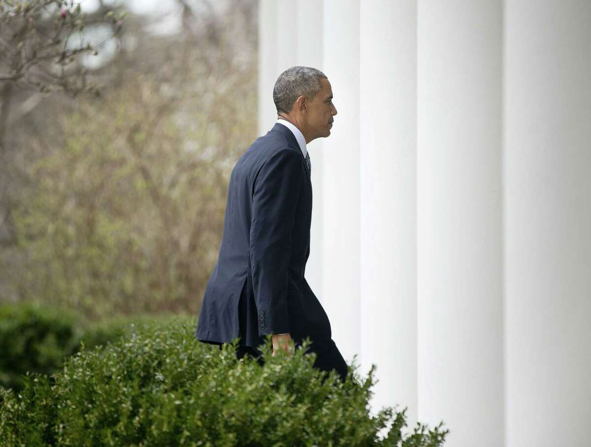 President Barack Obama walks back to the Oval Office after speaking in the Rose Garden of the White House in Washington on April 2.