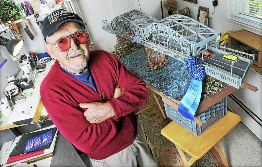 Joseph Virgadula is shown in his design studio at his Portland home with his award-winning model of the Middletown-Portland Arrigoni Bridge. Virgadula, who has macular degeneration, spent one month designing his model of the bridge and three months constructing using everything from cutting his own balsa wood, to toothpicks and wooden paint stirrers. Photo: File Photo   / TheMiddletownPress