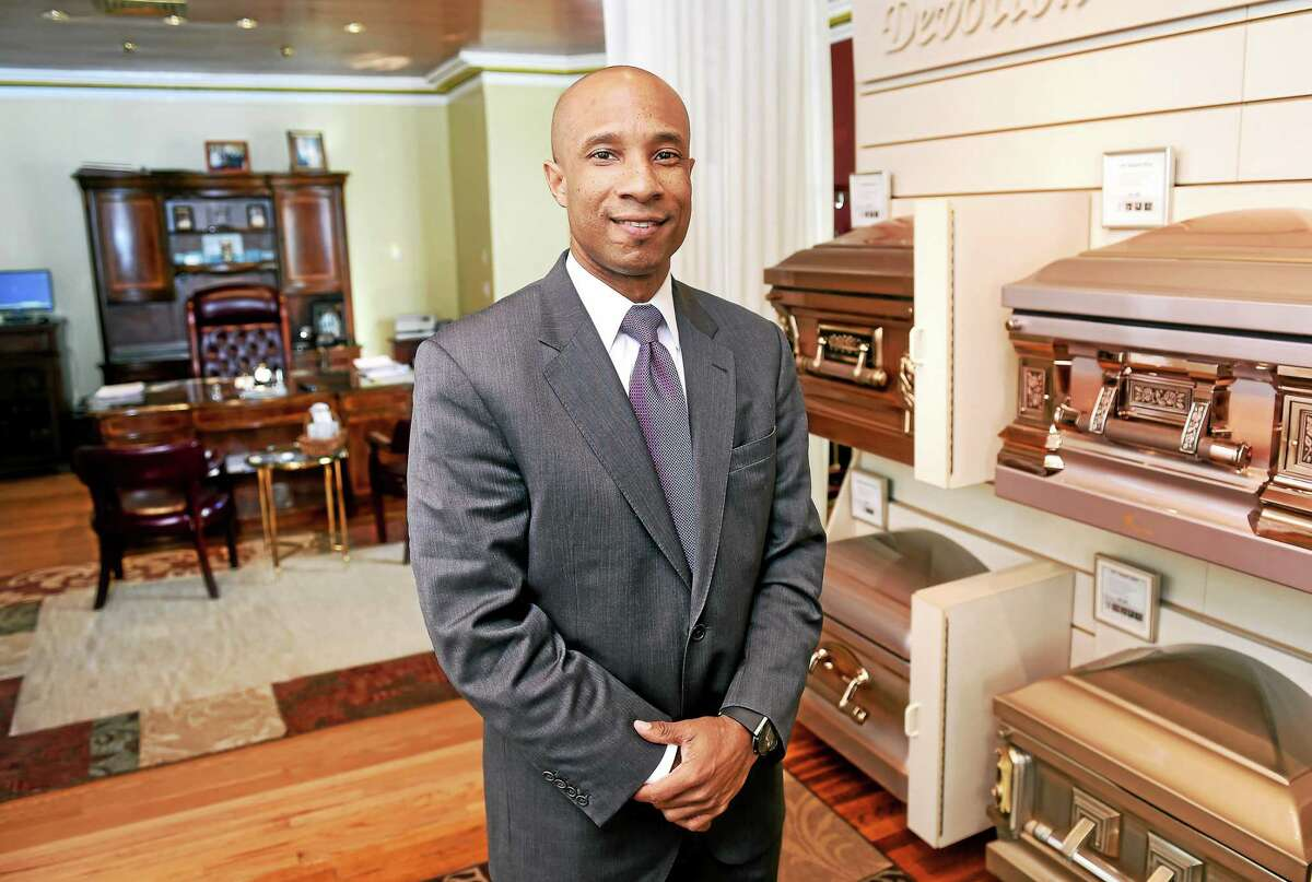 Howard K. Hill, owner of Howard K. Hill Funeral Services, is photographed in his New Haven showroom/office on 1/8/2015.