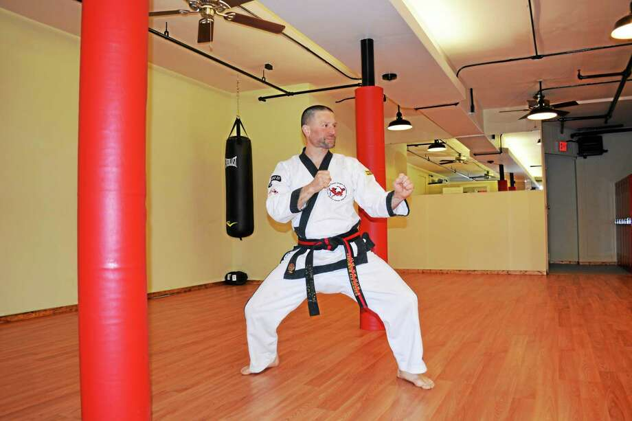 Frank Sinicrope, fourth-degree black belt and owner of Western Karate Federation on 191 Main St., poses in his studio. Photo: Brian Zahn — The Middletown Press