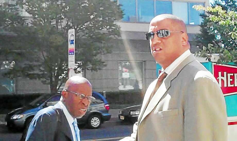 Tate George (right) leaves federal court in September 2013 for the lunch break at his trial for ponzi scheme. Photo: Trentonian File Photo - Paul Mickle