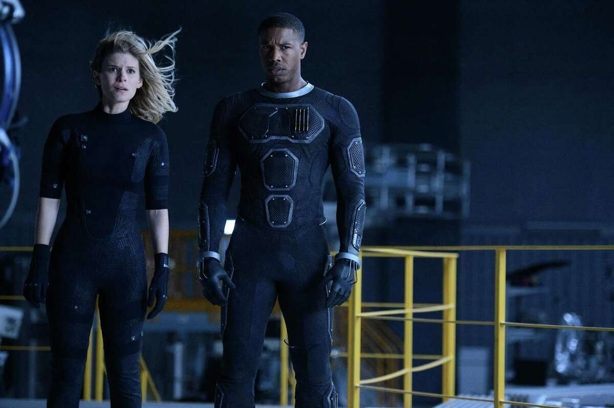 """This photo provided by Twentieth Century Fox shows, Kate Mara, left, as Sue Storm, and Michael B. Jordan as Johnny Storm, in a scene from the film, """"Fantastic Four."""" The movie releases in U.S. theaters on Aug. 7, 2015."""