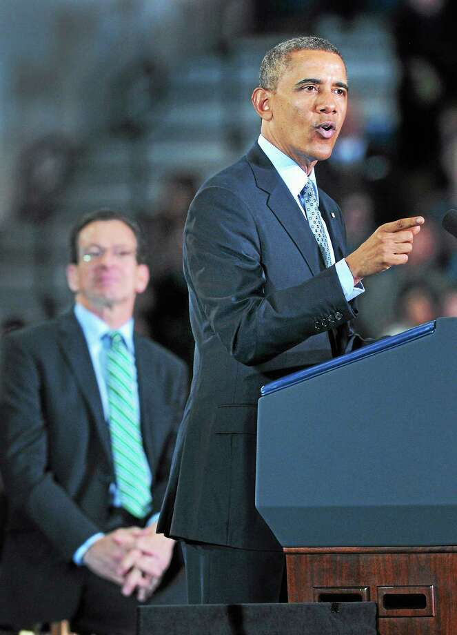 Arnold Gold - New Haven Register President Barack Obama speaks about raising the minimum wage at Central Connecticut State University in New Britain Wednesday. At left is Gov. Dannel P. Malloy. Photo: Journal Register Co.
