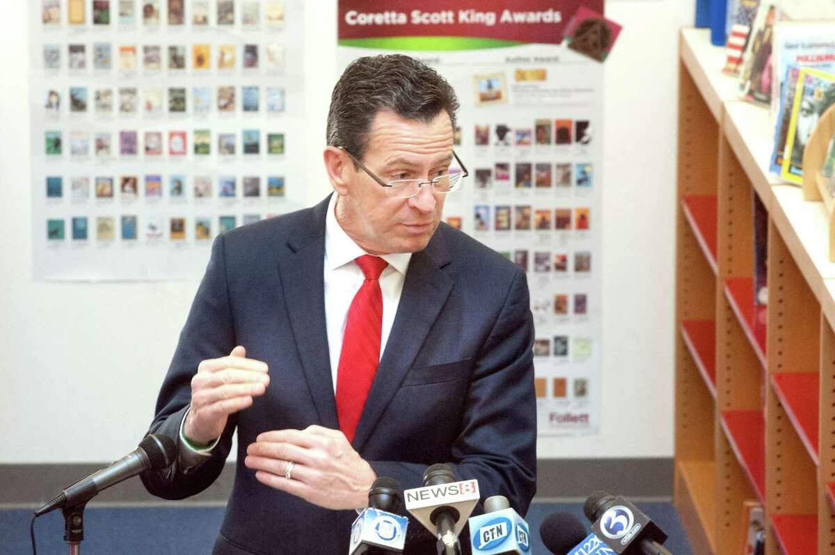 Gov. Dannel Malloy speaks at a press conference at Helen Street School in this February 2014 file photo.