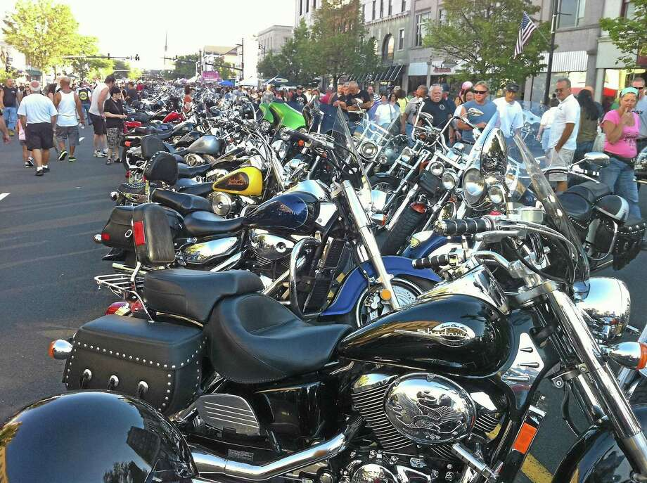 Crowds on Main Street in Middletown admire motorcycles during the annual Motorcycle Mania event in August 2011. Photo: Middletown Press File Photo