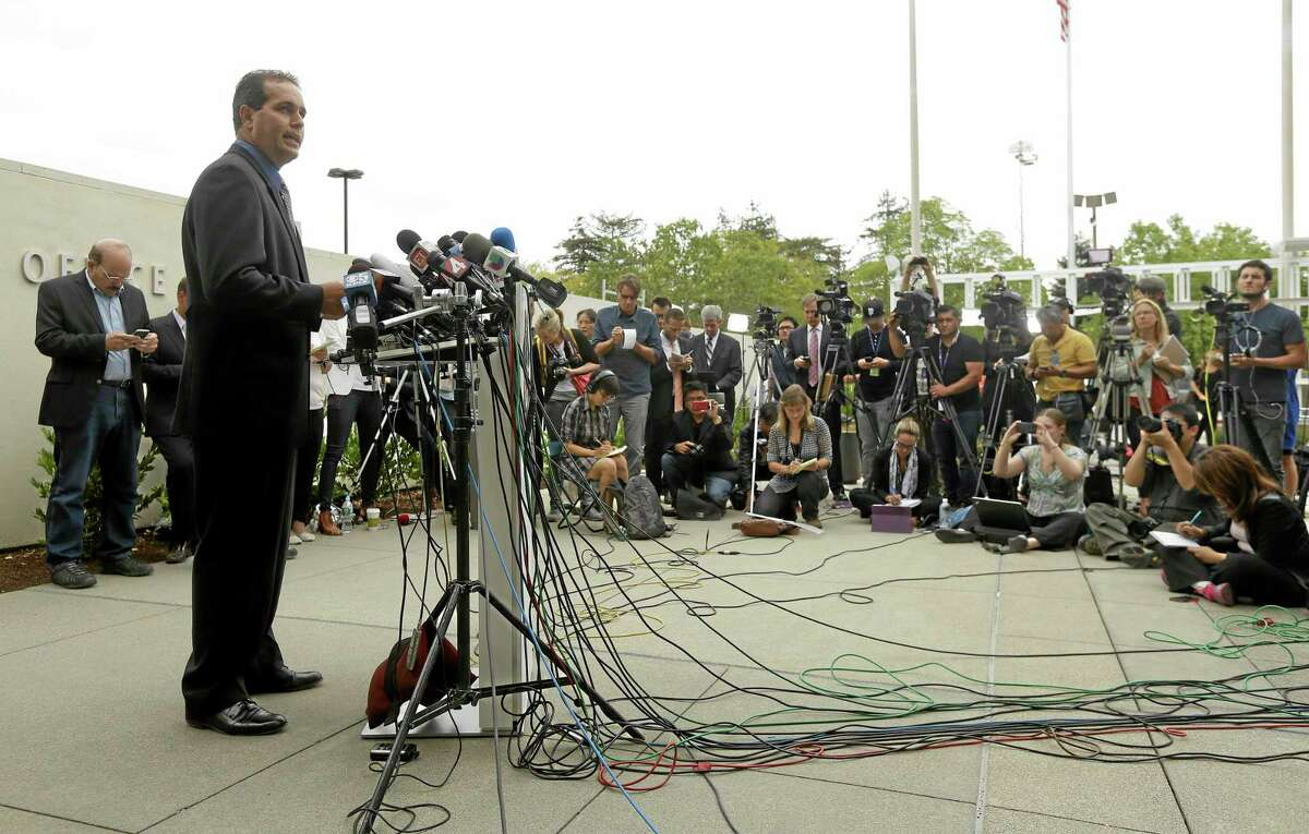 Lt. Keith Boyd, assistant chief deputy coroner for the Marin County Sheriff's Office, speaks at a news conference about the death of Robin Williams in San Rafael, Calif., Tuesday, Aug. 12, 2014. Boyd said Tuesday that Williams killed himself by hanging at his San Francisco-area home. (AP Photo/Jeff Chiu)