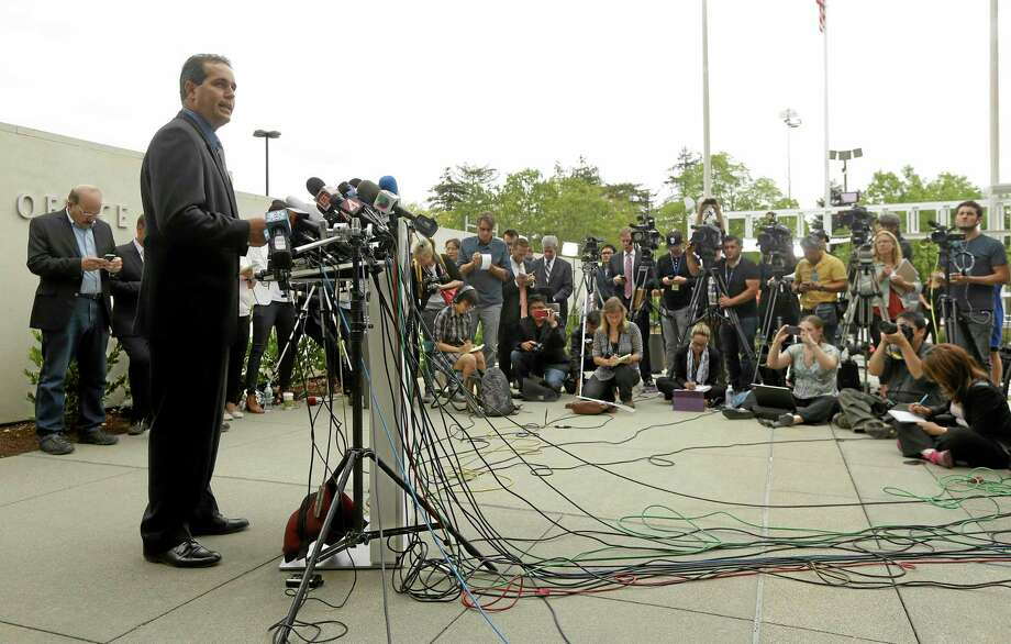 Lt. Keith Boyd, assistant chief deputy coroner for the Marin County Sheriff's Office, speaks at a news conference about the death of Robin Williams in San Rafael, Calif., Tuesday, Aug. 12, 2014. Boyd said Tuesday that Williams killed himself by hanging at his San Francisco-area home. (AP Photo/Jeff Chiu) Photo: AP / AP
