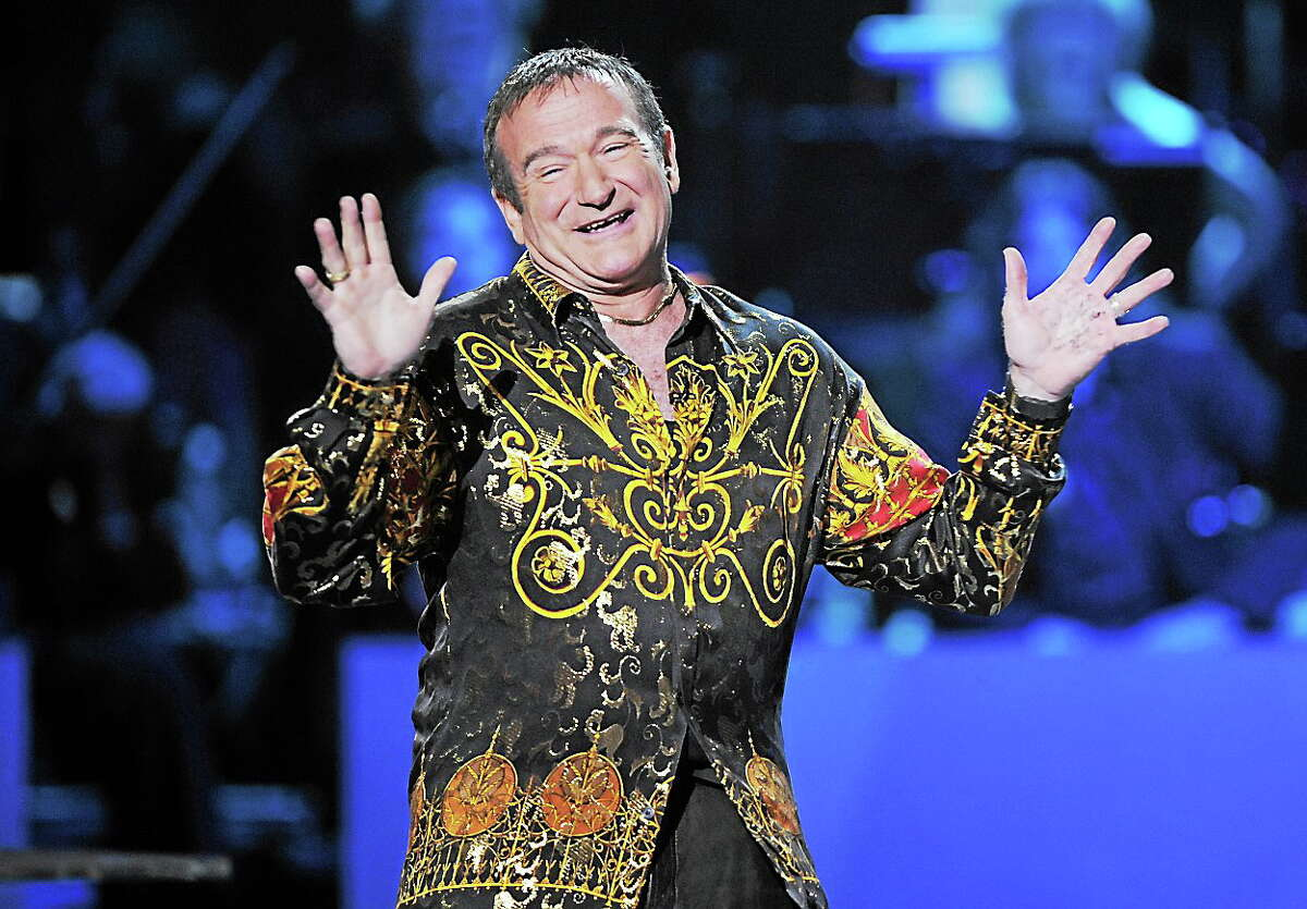 (AP Photo/Mark J. Terrill, File) This April 6, 2008 photo shows actor-comedian Robin Williams speaks on stage at the