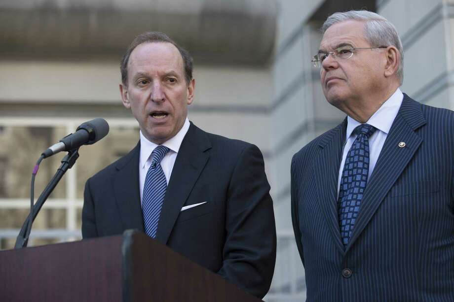 Attorney Abbe Lowell speaks alongside U.S. Sen. Bob Menendez after leaving the Martin Luther King Jr. Federal Courthouse following his client's arraignment Thursday. Photo: AP Photo  / AP