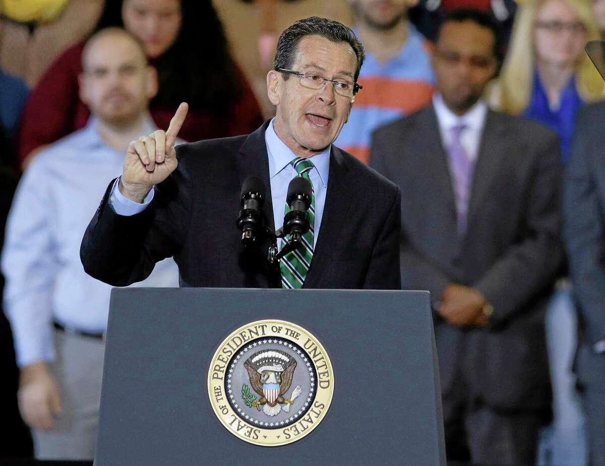 Connecticut Gov. Dannel P. Malloy introduces President Barack Obama before Obama spoke about the minimum wage during an event in Kaiser Hall on the Central Connecticut State University campus in New Britain, Conn., Wednesday, March 5, 2014. Obama traveled to the Hartford, Conn., area to highlight the importance of raising the minimum wage and then will travel to Boston for a pair of Democratic fundraising. (AP Photo/Stephan Savoia)