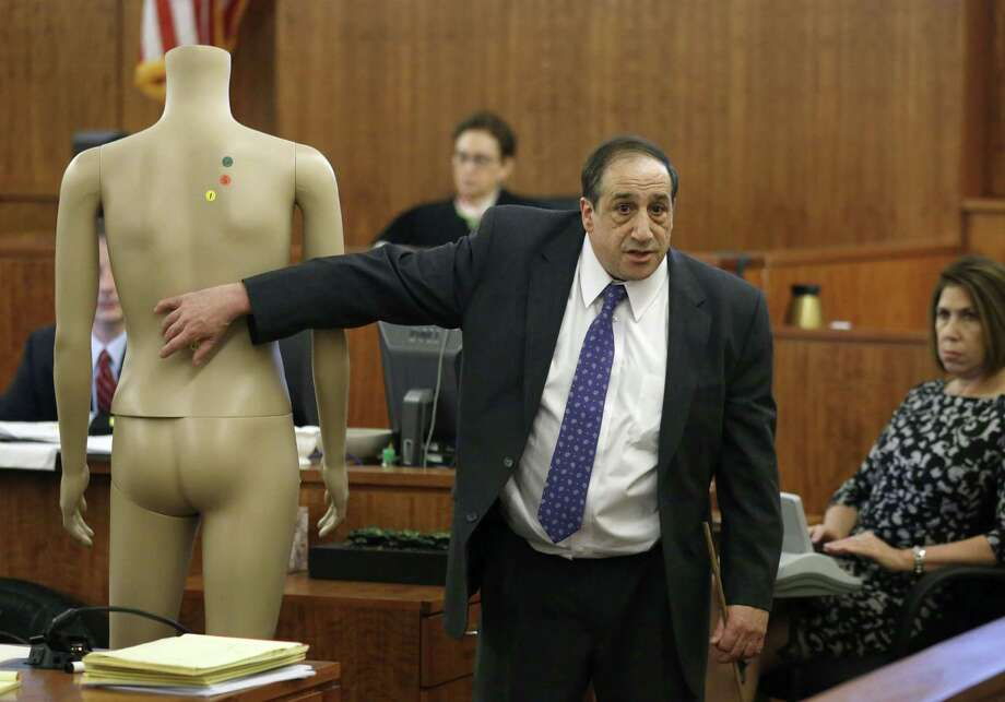 William Zane, of the Massachusetts state medical examiner's office, points to a mannequin while testifying about the location of bullet wounds in the body of Odin Lloyd during the murder trial of Aaron Hernandez on Thursday in Fall River, Mass. Photo: Steven Senne — The Associated Press  / Pool AP