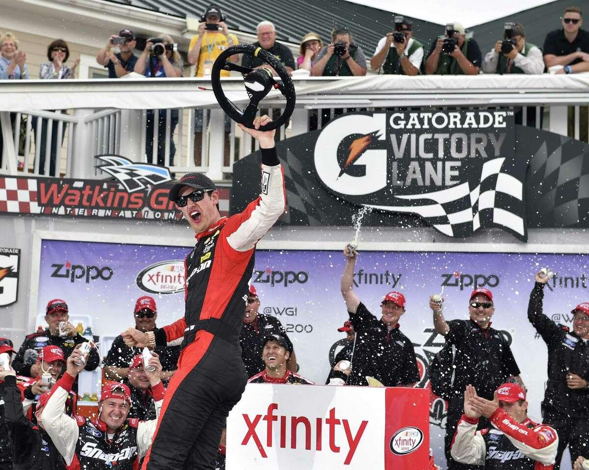 Joey Logano celebrates in victory lane after winning the NASCAR Xfinity race at Watkins Glen International on Saturday in Watkins Glen. N.Y.