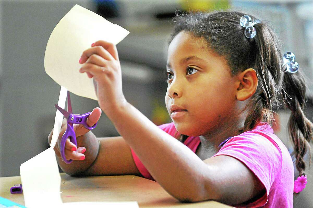 """First-grade student Rebecca Gadlin, 5, works on a """"Read Color Words"""" project in Lauren Silberkleit's class at Farm Hill on the first day of school for Middletown Public Schools in 2013."""