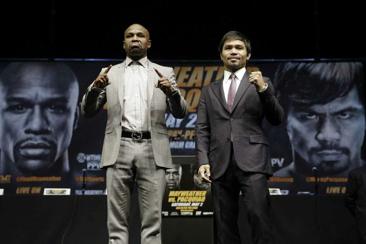 In this March 11 file photo, boxers Floyd Mayweather Jr., left, and Manny Pacquiao pose for photos after a news conference in Los Angeles. The two are scheduled to fight in Las Vegas on May 2.