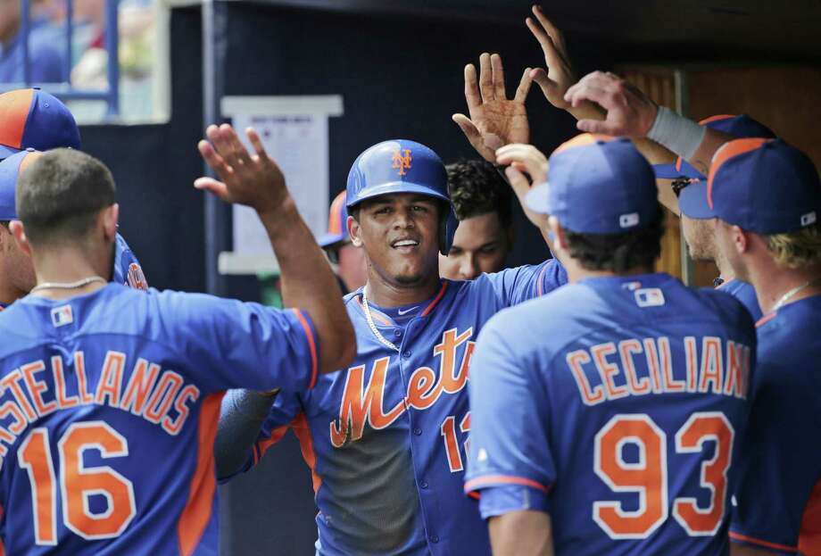 The New York Mets completed a new contract with Juan Lagares that guarantees the center fielder $23 million from 2016-19, including a buyout of a $9.5 million option for 2020. Photo: Kathy Willens — The Associated Press  / AP