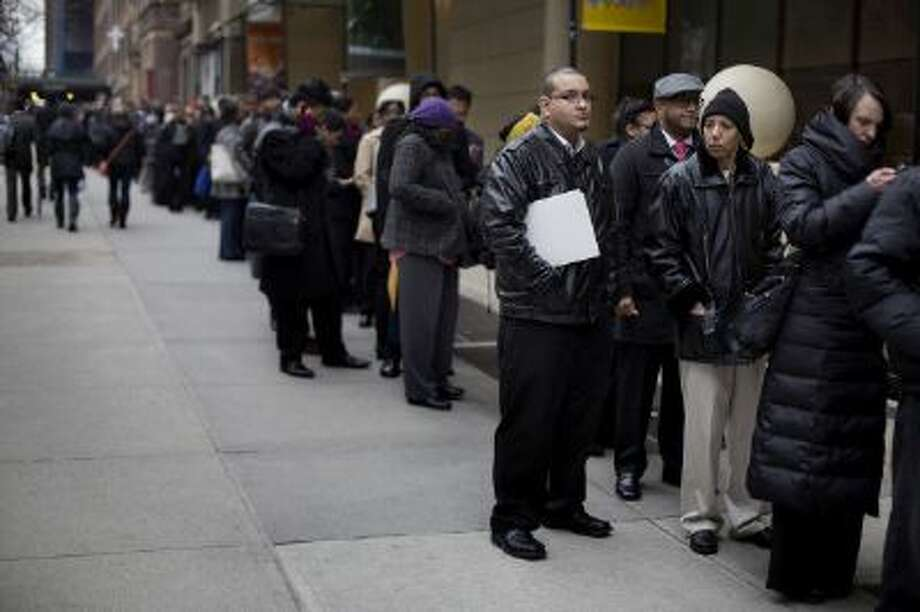 Job seekers wait in line to enter a job fair in New York, U.S., on Thursday, Jan. 16, 2014. Jobless claims decreased by 2,000 to 326,000 in the week ended Jan. 11, the least since the end of November, from a revised 328,000 in the prior period, a Labor Department report showed today in Washington. Photograph: Victor J. Blue/Bloomberg via Getty Images Photo: Bloomberg Via Getty Images / 2013 Bloomberg
