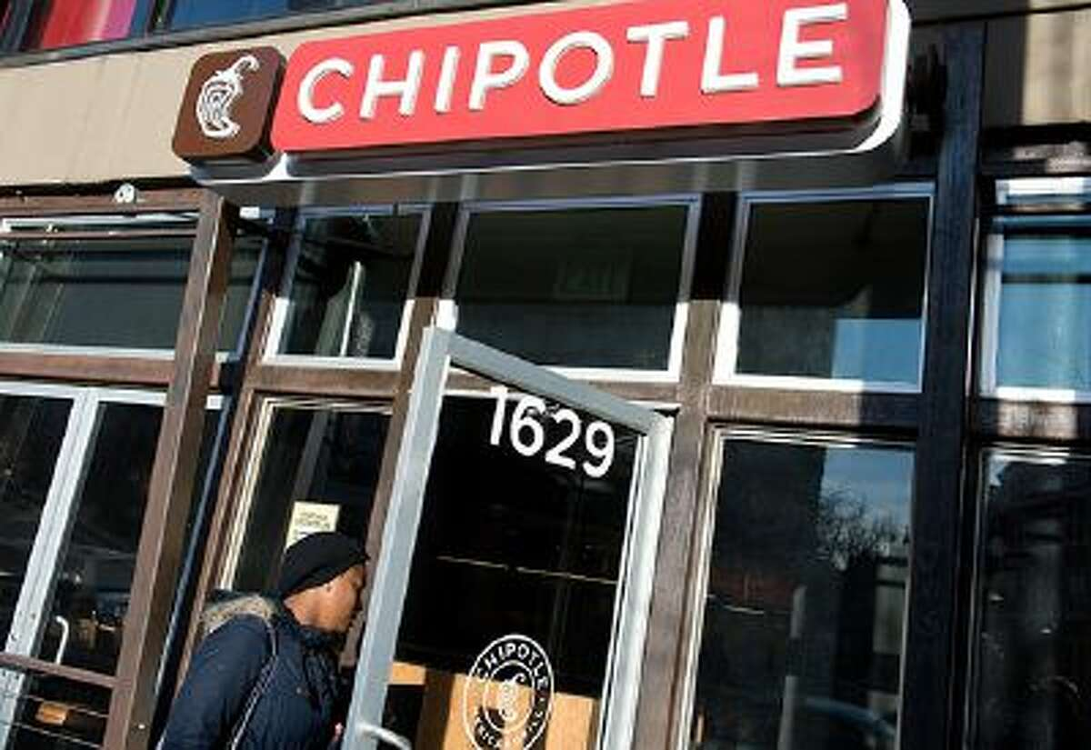 A woman walks into a Chipotle restaurant in Washington on January 31, 2014. Feisty restaurant chain Chipotle Mexican Grill bucked the tide of lethargic holiday sales, helped by a widely-seen video that mocked factory farming to highlight its emphasis on healthy ingredients. Chipotle, which describes its mission as