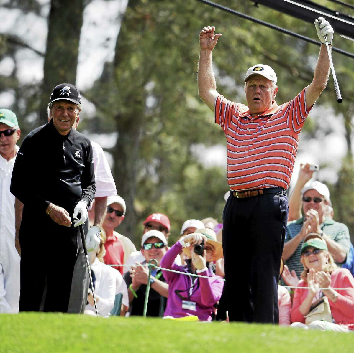 Gary Player, left, watches as Jack Nicklaus reacts to his tee shot on the first hole during the par-3 competition at the Masters on April 9 in Augusta, Ga.
