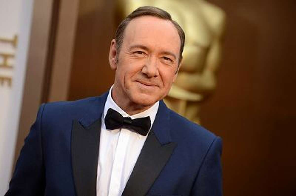 Kevin Spacey arrives at the Oscars on Sunday, March 2, 2014, at the Dolby Theatre in Los Angeles. (Photo by Jordan Strauss/Invision/AP)