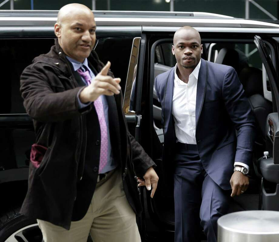 Adrian Peterson, right, arrives for a hearing for the appeal of his suspension in New York on Tuesday. Photo: Seth Wenig — The Associated Press  / AP