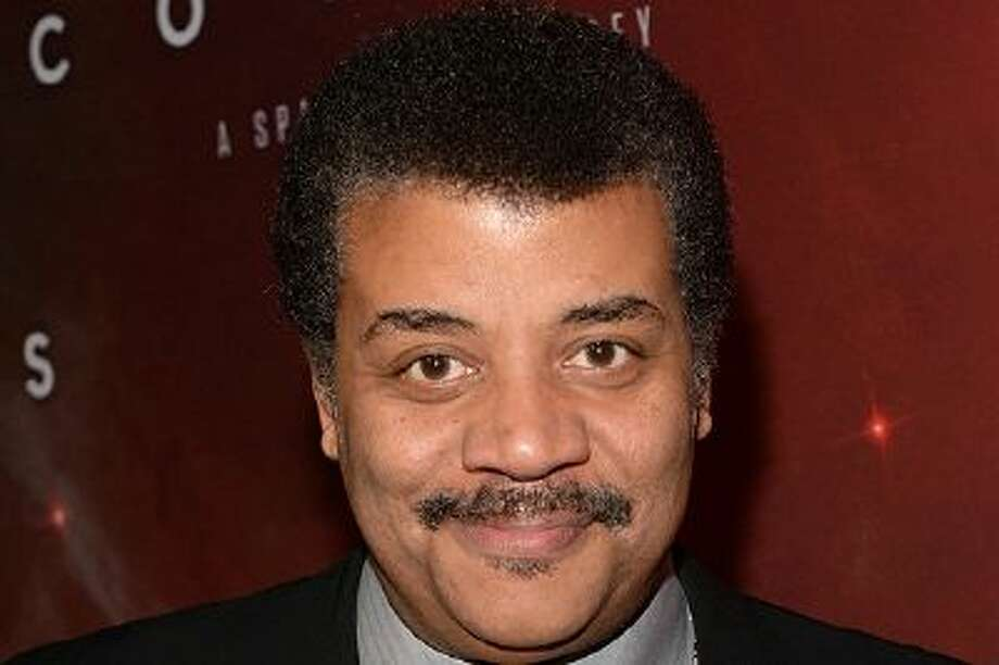 """LOS ANGELES, CA - MARCH 04:  Host Neil deGrasse Tyson attends the premiere of Fox's """"Cosmos: A SpaceTime Odyssey"""" at The Greek Theatre on March 4, 2014 in Los Angeles, California.  (Photo by Jason Kempin/Getty Images) Photo: Getty Images / 2014 Getty Images"""