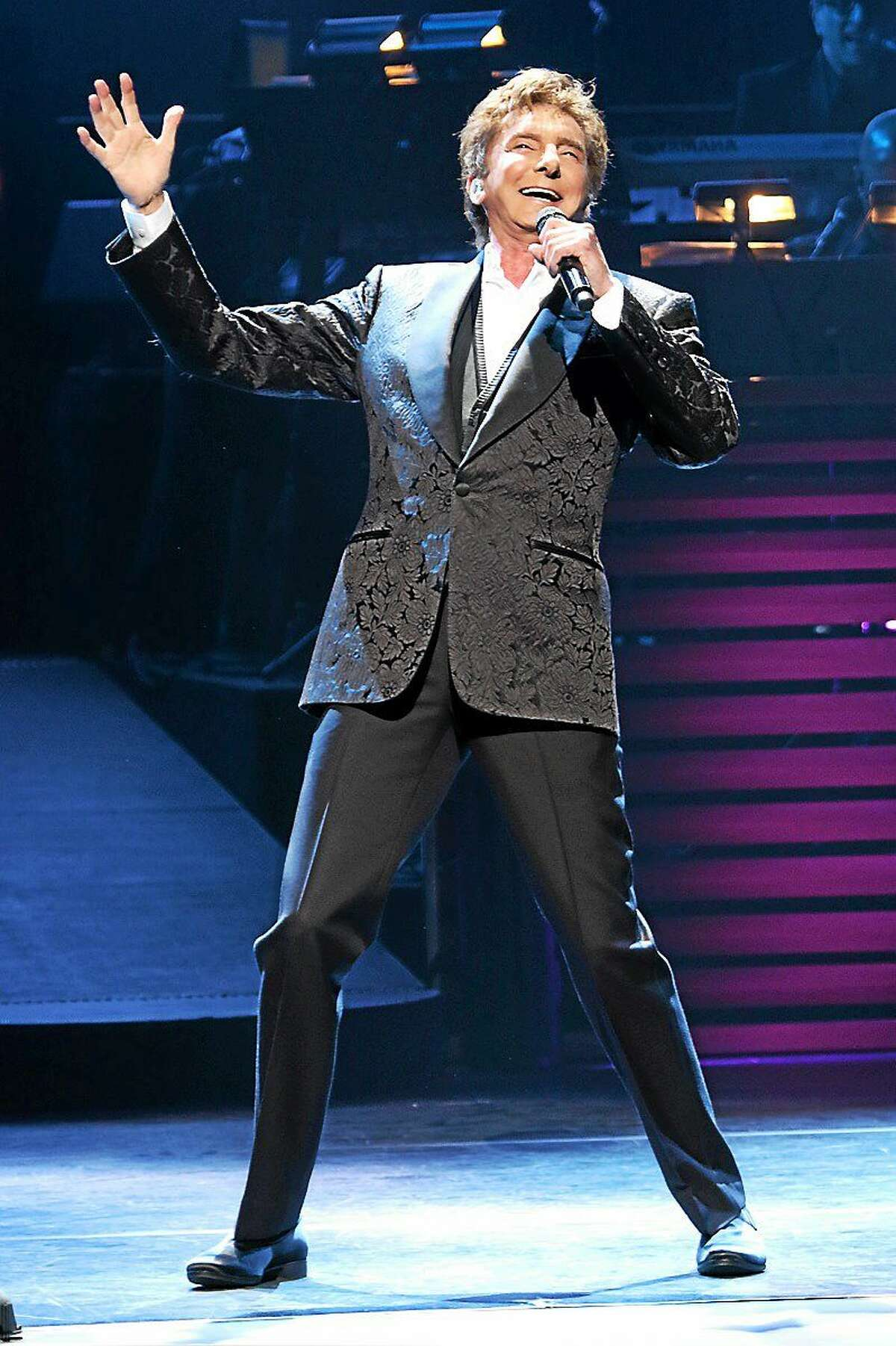 Photo by John Atashian Singer and songwriter Barry Manilow is shown performing on stage at the Foxwoods Resort & Casino in Mashantucket during his concert on March 28. At 71 years old with 51 years in the music business, this living legend is still going strong. He entertained the sold-out crowd of fans to a night full of his biggest hits.