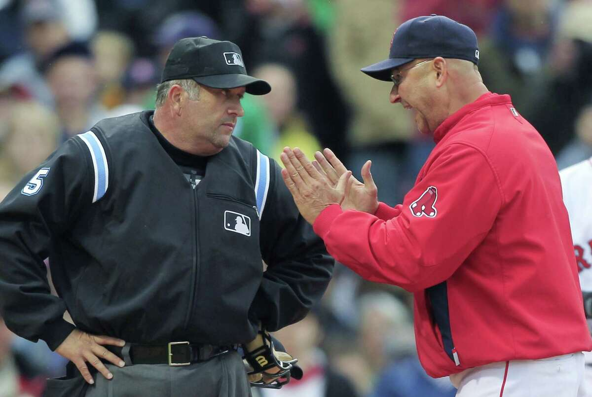 In this May 12, 2010 file photo, Boston Red Sox manager Terry Francona argues a strike call with home plate umpire Dale Scott. The 55-year-old umpire who has worked three World Series told the website outsports.com that he married his longtime companion in November 2013.