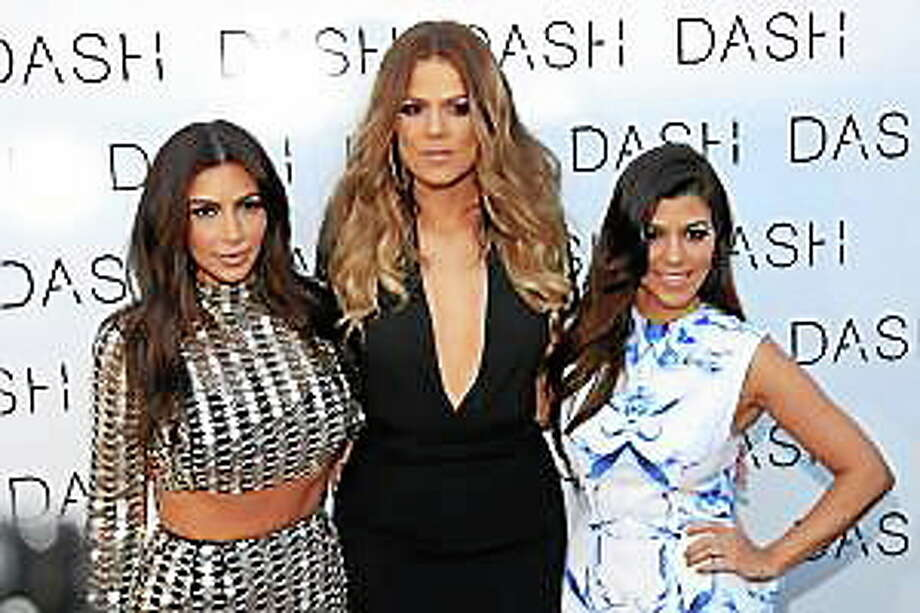 From left, Kim Kardashian, Khloe Kardashian and Kourtney Kardashian attend The Kardashian Family Celebrates the Grand Opening of DASH Miami Beach on Wednesday, March 12, 2014, in Miami Beach, Fla. Photo: (Omar Vega — The Associated Press) / AP2014
