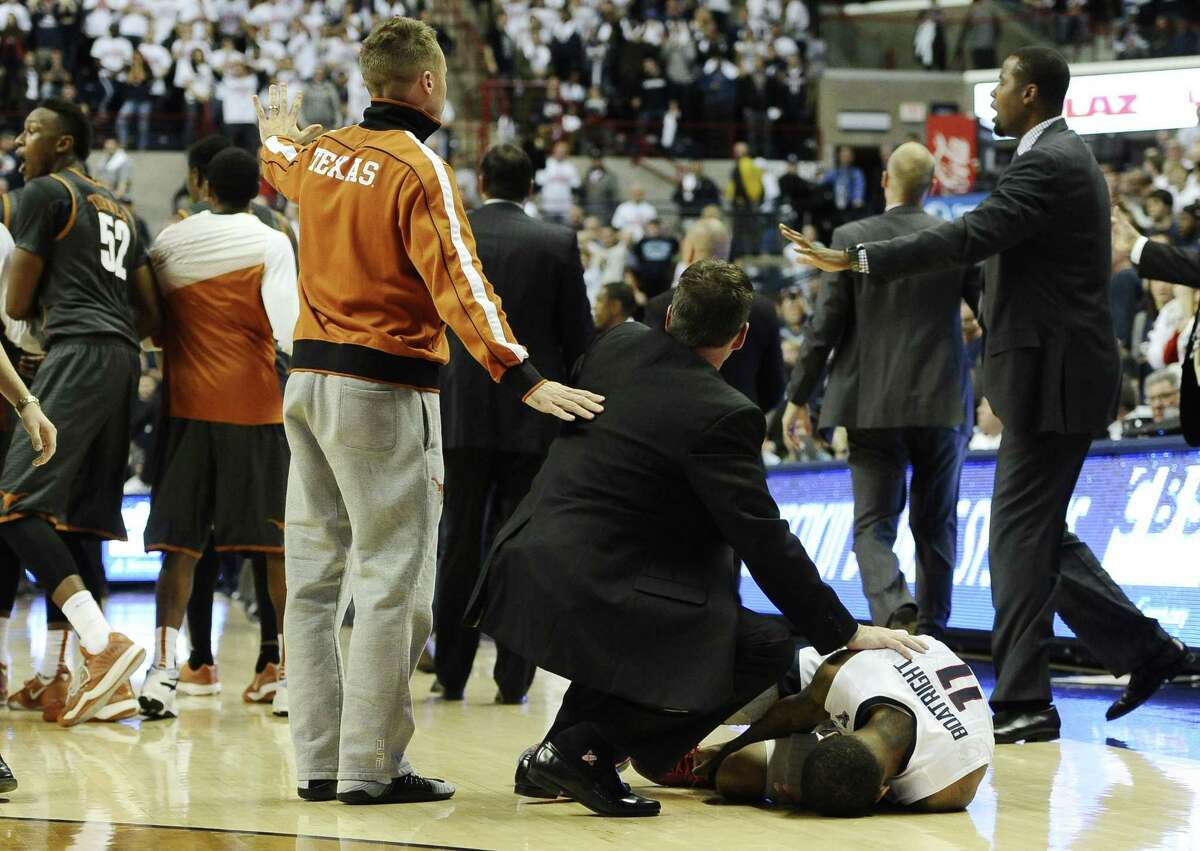 UConn's Ryan Boatright lies injured on the court at the end of the Huskies' 55-54 loss to Texas on Sunday at Gampel Pavilion in Storrs.