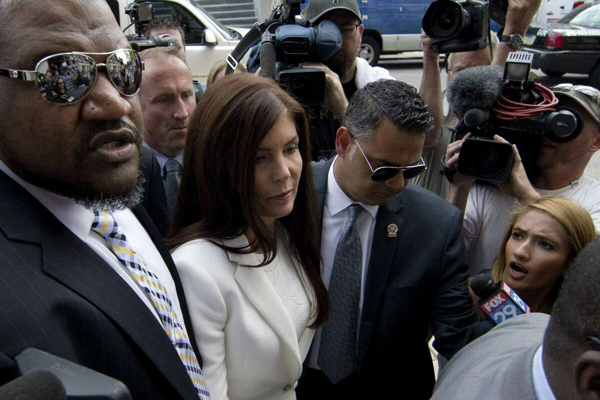 Pennsylvania Attorney General Kathleen Kane arrives Saturday, Aug. 8, 2015, to be processed and arraigned on charges she leaked secret grand jury material and then lied about it under oath at the Montgomery County detective bureau in Norristown, Pa. Kane, the state's first elected female attorney general, vows to fight the charges, which include perjury, obstruction and conspiracy.