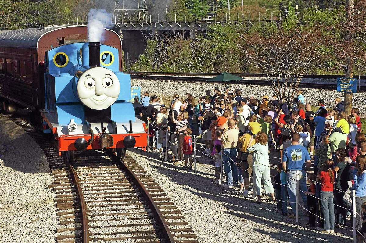 Contributed photos Thomas the Tank Engine pulls into the station in Essex, greeting a crowd of happy, waiting passengers.