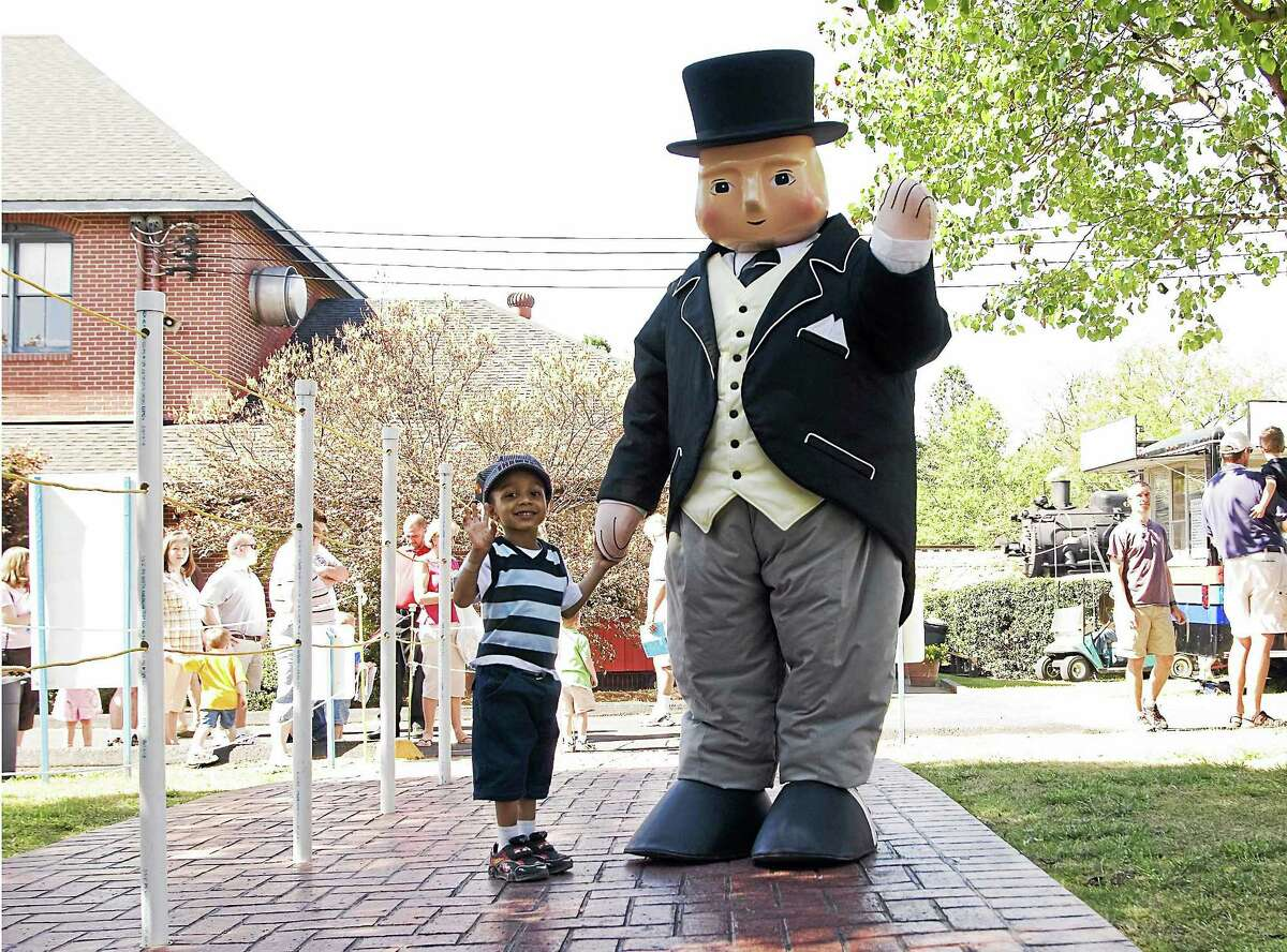 Contributed photos Sir Topham Hat greets a young fan.