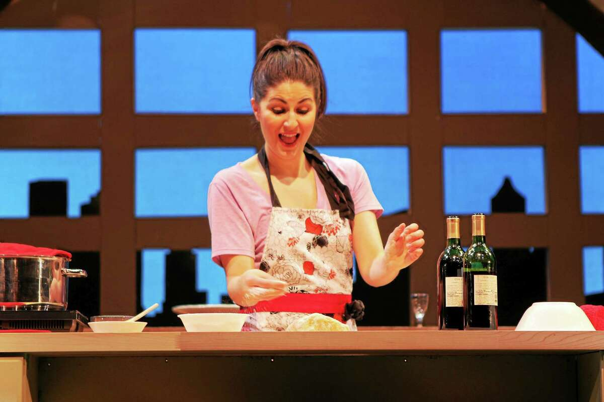 """Photo courtesy of Seven Angels Theatre The charming and versatile Giulia is being brought to delectable life in the hands and hospitality of Maria Baratta as she cooks up a fabulous feast right before your eyes in """"I Loved, I Lost, I Made Spaghetti,"""" a memoir by Giulia that has been cleverly adapted by Jacques Lamarre. The play runs to April 26 at Seven Angels Theatre, Waterbury."""