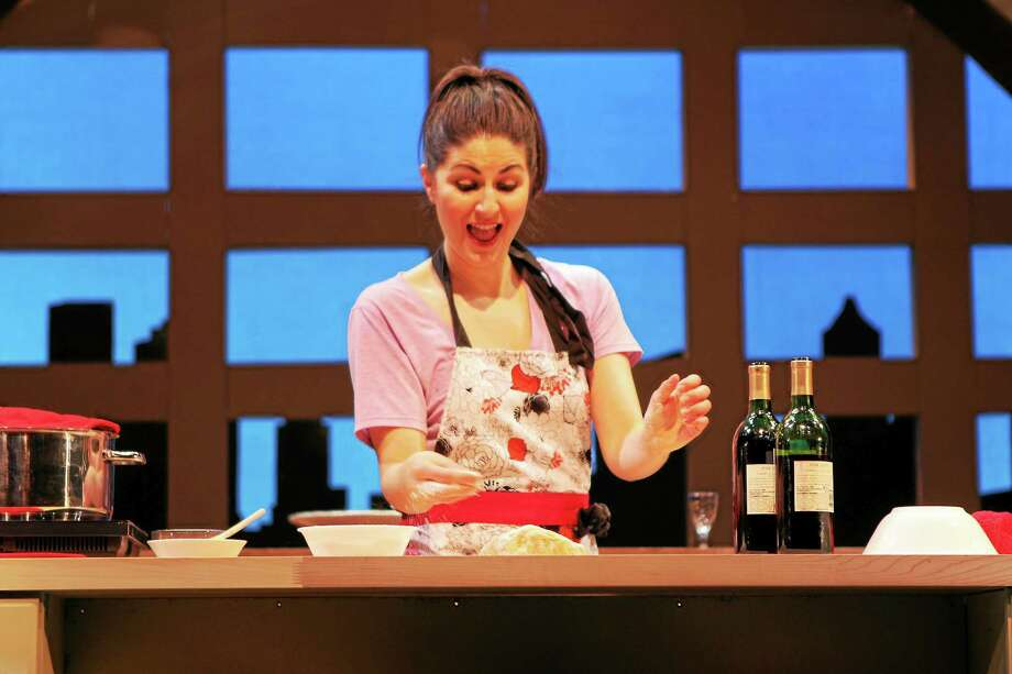 """Photo courtesy of Seven Angels Theatre The charming and versatile Giulia is being brought to delectable life in the hands and hospitality of Maria Baratta as she cooks up a fabulous feast right before your eyes in """"I Loved, I Lost, I Made Spaghetti,"""" a memoir by Giulia that has been cleverly adapted by Jacques Lamarre. The play runs to April 26 at Seven Angels Theatre, Waterbury. Photo: Journal Register Co."""