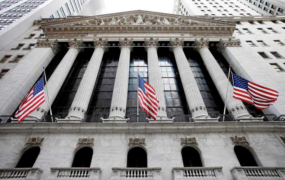 In this Feb. 10, 2011, photo, American flags fly in front of the New York Stock Exchange. Photo: Mark Lennihan — The Associated Press  / AP